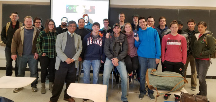 Professor Sundar Atre (front, in blazer), Endowed Chair of Manufacturing and Materials, and students participating in the new UofL 3-D Printing Business Incubator.