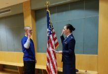 Andrew Aschbacher, doctor of nursing practice student at UofL, is commissioned into the Air Force by Maj. Angela Washington, a School of Nursing faculty member.