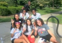 MLK Scholars at a community service event at Iroquois Park. Back row standing: Nuri Thompson. Middle row: Erica Gaither, Noela Botaka, Manuela Botaka. Front row: Taylor Hinna Williams, Elizabeth Peña, Elijah Ervin.