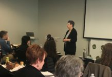 Mona Huff, community organizer, presents at an event