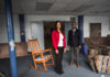 Kent School faculty Emma Sterrett-Hong and Maurice Gattis stand in a room of the soon-to-be opened Sweet Evening Breeze homeless shelter for LGBT youth.