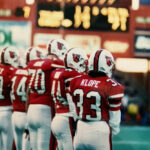 Kathryn Klope vanTonder stands alongside several teammates at a football game in the old Cardinal Stadium.