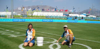 UofL Professor Mary Hums (right) at the Athens Olympics in 2004