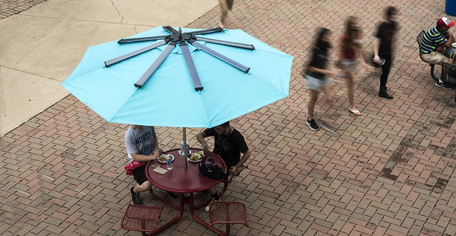 The Powersol table and umbrella will permanently reside in the courtyard at Bettie Johnson Hall.