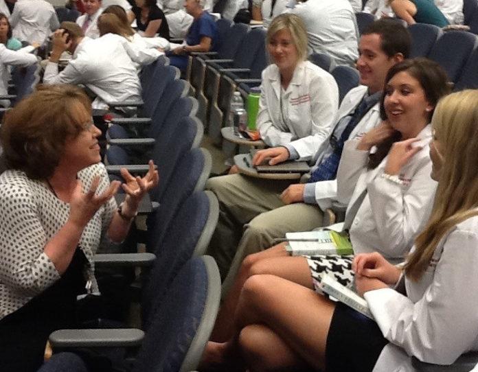 Vida Vaughn, Kornhauser clinical librarian, interacts with dental students during a seminar break.