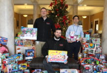The UofL House Staff Council collected 870 gifts during its Toys for Tots campaign this month. Resident physicians pictured are (from left) Jamie Morris, M.D., Jared Winston, M.D., and Taro Muso, M.D.