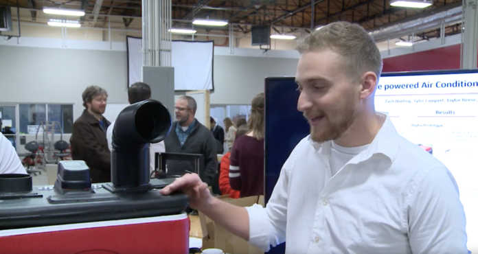 Mechanical engineering student Tyler Lampart presents his cooler-air conditioner prototype during Capstone showcase.