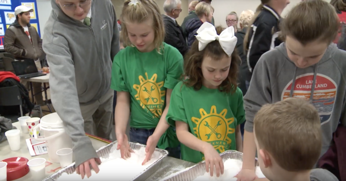 Young, future scientists play with a snow-like substance called sodium polyacrylate.