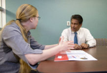 K.B. Kulasekera, Ph.D., talks with a student