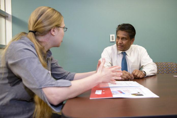K.B. Kulasekera, Ph.D., talks with a student