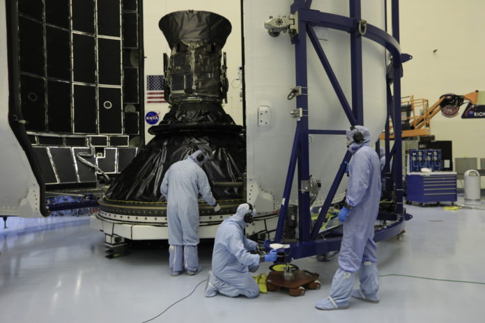 Technicians prepare NASA's Transiting Exoplanet Survey Satellite (TESS) for encapsulation in the SpaceX payload fairing inside the Payload Hazardous Servicing Facility at the agency's Kennedy Space Center in Florida.