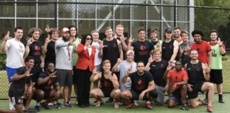 The UofL Rugby Team poses with President Neeli Bendapudi