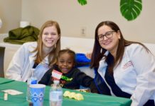 The Shop with a Dentist program pairs UofL dental students with underserved elementary students.