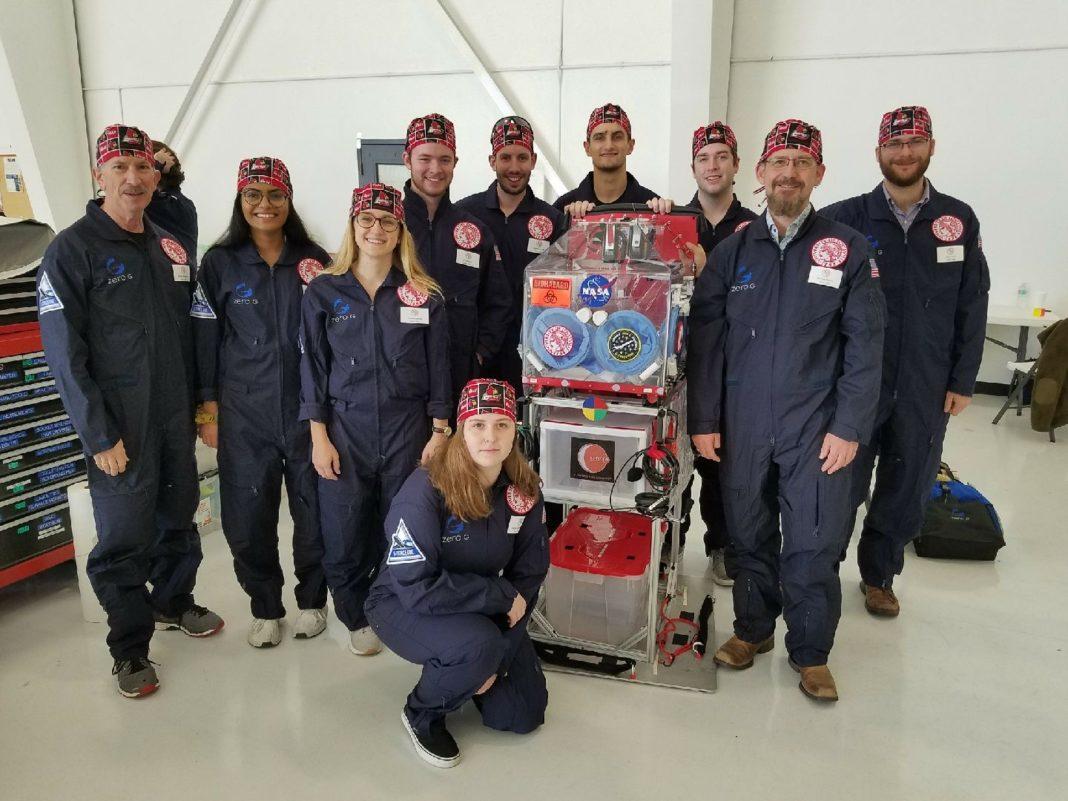 Research crew preparing to board ZERO-G aircraft with the glovebox. Left to right: George Pantalos, Ph.D., Riya Patel, Brooke Barrow, John Moore, Connor Centner, Charles Elder, David Grimm, Michael Menze, Ph.D., Brett Janis and Sienna Shacklette (kneeling).