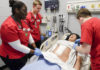 Undergraduate nursing students learn together in the simulation lab.