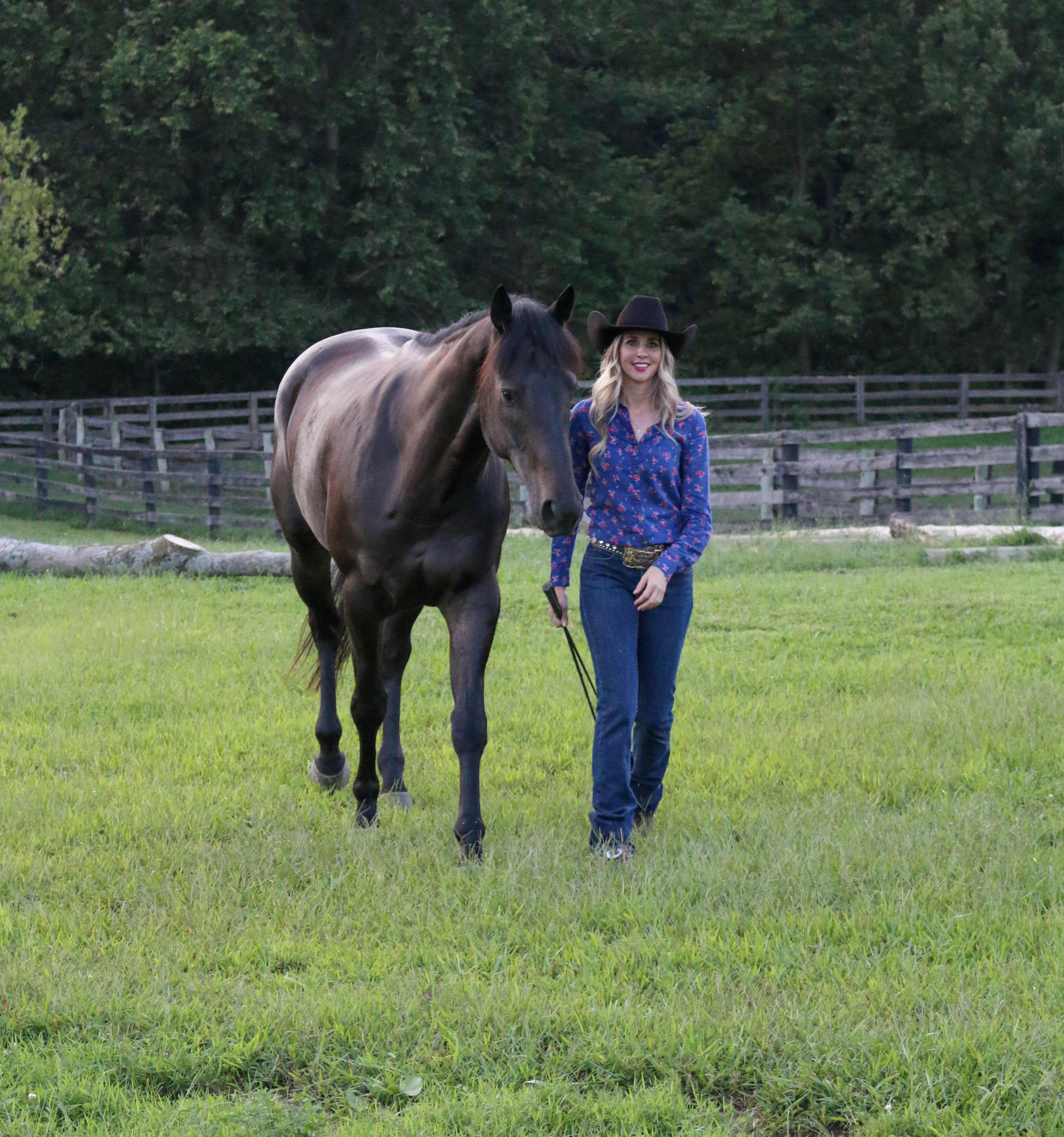Elizabeth James, Ph.D., with her horse, Ozzie. (Photo by Dan James)