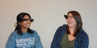 Lekha Devara and Briana Coleman, second-year medical students, wearing smart glasses.