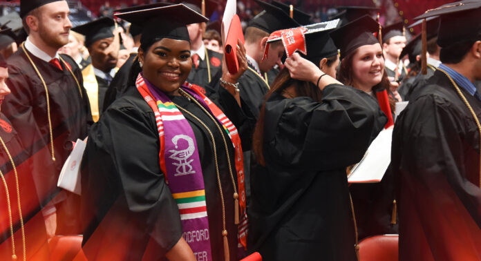 University of Louisville graduates at a commencement ceremony