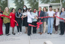 UofL leaders, along with staff and students cut a ribbon symbolizing the opening of the Cultural and Equity Center.